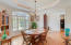 Formal dining room with tray ceiling and up-lighting