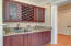 Solid cherry cabinetry wet bar in dining room, perfect for entertaining