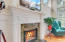 Extensive trim / molding and Imported granite from Spain surround the gas fireplace