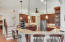 Chef's kitchen with solid cherry cabinets, stainless appliances, and more