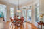 Eat-in-kitchen with inverted pan ceiling and custom trim package, a wall of windows/doors leading to screened porch