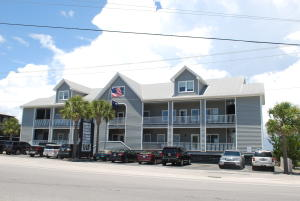103 Palm Blvd, roadside view, only waterfront office condos available.