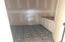 Laundry room has navy and white encaustic tile, sink and cabinets. Soft close features here, too.