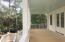 2269 Screen Porch, with views of creeks and marsh, is an extension of the family room