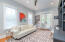Bedroom/office has built-in bookshelves and French doors that open onto screened porch.