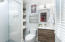 Completely renovated to perfection featuring a floating vanity, sliding glass shower door and reclaimed wood shelving