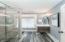 High end renovations include floating vanity, sliding glass shower door and designer tile