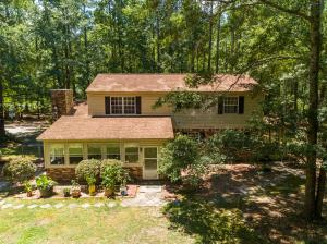 Beautiful 2 story country style home with wrap around porch & attached side entry 2 car garage. All nestled on an almost 3 acres of wooded privacy just 10 minutes from downtown Summerville. Huge detached garage/workshop located in the backyard. Workshop has 220 electric service.