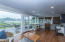 Glass filled sunroom offers close to panoramic views and has a separate heating and cooling unit