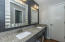 Shared updated bathroom w/ granite counters and double sinks.
