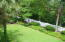 Private, large landscaped fenced back yard protected by lots of trees.