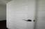 PANELED DOORS WITH BRONZE LEVERS