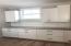 More kitchen prep space near the oversized pantry. White diamond backsplash to be installed.