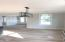 """2267 Foyer and Dining Area - notice the cove crown, wainscoting and 8"""" base. All windows are Andersen impact resistant! Floor is 5"""" white oak."""