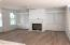 Shiplapped gas fireplace and custom built-in shelving