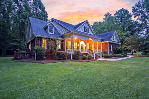 Gorgeous Southern Living home on 2.49 acres in the peaceful, lovely gated community of Moody's Plantation. Two serene lakes, mature trees & spaced out lots mean you get to spend more time admiring hummingbirds, deer & wildlife. A southern front porch & windows all along the back of the home really allow you to appreciate this gorgeous setting. Inside, this sprawling residence is move-in ready & well-appointed with hardwood floors, a granite eat-in kitchen, fireplace in the family room, a huge media room & an oversized two-car garage as well as a detached one-car garage. Just minutes from the Cane Bay Publix shopping/dining center, the new Roper Hospital and Volvo, you'll love this private yet convenient location! Additional features include:  -Great home for entertaining both inside and outside -Spacious backyard...approximately one acre -Beautiful trim work throughout -Lots of natural light and windows -Hardwood floors 3/4 solid pre-finished -Chair rail molding in the dining room -Built-ins on either side of the fireplace in the family room -Kitchen has granite counters, tile floorings and a built-in desk area -Large media room for movies and games with an alcove for exercise equipment -Master bedroom has a walk-in closet -Master bath features a jetted tub, two vanities and walk-in shower -Solid core interior doors. -All interior walls are insulated including the garage. -Weather Shield double paned windows. -Encapsulated Crawlspace with Dehumidifier. -New Air Conditioner/Heat Pump for 1st floor installed July 2019 -Ceramic Tile in Kitchen and Baths -Internet: Fiber Optics cable for High Speed Networking  -Central vacuum system -Kitchen Appliances approximately 2 yrs. Old  -Water Heater approximately 1 year old  Book your showing today!