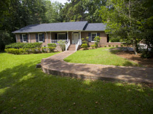 Unique unique unique property near downtown Summerville is sitting on an Acre lot! This One Story All Brick Home offers 3 Large Bedrooms and 2 Full Bathrooms AND 2 Bedrooms and 1 Bathroom in the BASEMENT. That's right, there is a basement in this home. 208 E. Carolina Avenue boasts gorgeous refinished hard wood floors and neutrally Interior Walls throughout the entire home. Upon entering the home, you are greeted to a proper foyer with the formal dining room to the left and the formal living room to the right. The oversized living room has a Wood Burning Fireplace. Proceed through the living room and you will enter what I consider a bright and open Family Room with lots of windows. To the left of the Family Room, you enter yet another large room that I would call either a Study or a 'Den' and features a 2nd Wood Burning Fireplace and built-in bookshelves. With 4 Large Rooms (Dining, Living, Family and Den), the overall living space in this home is amazing. The retro kitchen sits right in the middle of all four living spaces, perfect for entertaining. The three large bedrooms are to the left side of the home. The master Bedroom has its own bathroom and the two secondary bedrooms share a Full Hall Bathroom. The very Unique feature to this home and to the Low Country in general is a Basement. The sqft for the basement was NOT included in the living space of 2889sqft. The basement does add an extra 744sqft. In this space, the original owners had added 2 extra bedrooms and a bathroom with a toilet and shower. The height of the ceiling does not allow this space to be considered 'living' space. This unique property sits on .97 of an acre lot. Home is conveniently located within walking distance to the Harris Teeter shopping district and is minutes from the Historic Town of Summerville and attends the award winning Dorchester Two School System.