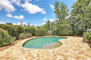 Executive home in Dunes West with saltwater pool, custom patio and landscaping