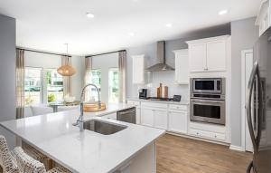 litchfield kitchen; this photo shows the gourmet kitchen upgrade; not actual home; model from another location; contact new home consultant for details