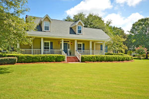 Wonderful custom built,  original owner home in popular Gadsden Manor. All the perks of living near downtown Summervillle yet none of the  headaches of owning an historic property!  This spacious and light filled home offers tons of living space, newer upgrades, custom moldings, double staircases & a fabulous backyard & deck perfect for grilling out & hanging out!  A grand Southern front porch welcomes you inside through the foyer and into the spacious family room offering built-ins, fireplace and lots of windows overlooking the private backyard.  The  eat-in kitchen w/ bay window connects to the family room & has white cabinets, upgraded counters, new appliances & custom backsplash. There is a also a formal dining room for the holidays! The downstairs master bdrm includes his & her walk in closets, a spa like bath w/ dual vanities, marble flooring and a walk-in shower with multiple jets and dual shower heads.  The second floor boasts another master bedroom with walk in closet, jetted tub, separate shower and double vanity. There are also two generously sized additional secondary bedrooms, full bath and a large bonus room that is the 5th bedroom but  could also be used as a media room or playroom. Extra's include walk in storage spaces, floored attic, hardwood floors, spacious laundry room, 2 car garage, irrigation system, beautiful landscaping, uplighting outside, tankless water heater, new windows and termite bond.  The outdoor living spaces include the spacious front porch, back deck and fenced in yard.  You are very conveniently located to downtown historic Summerville, shopping, restaurants,  parks, and major roads for an easy commute.