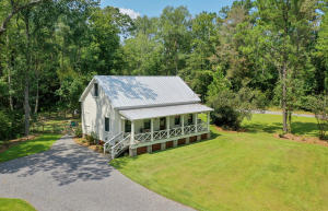 Own a piece of history with this newlyrenovated home that served as a church in the 19th century. This one of a kind southern charmed country cottage features a sweeping front porch, back deck to enjoy the surrounding woodlands, and the privacy offered by the gated entry. The home is full of character and South Carolina history. The restorers of the property were careful to keep many of the original elements intact and you will surely take note of the attention to quality throughout. A few of the original features preserved are the wood clapped walls and ceiling, window frames, even the original church doors and pulpit are repurposed. Modern upgrades include heart pine floors, new kitchen and bathrooms with granite countertops, 400 series Anderson glass windows, new roof, new HVAC... New water heater, and freshly painted throughout. The exterior of the home is low maintenance Hardiplank Board and Batten Fiber Cement Plank. The master suite is conveniently located downstairs. Upstairs offers 2 more bedrooms with a full bath and cozy loft. Also the property offers an additional well and is ready for an RV hook up.   The property is within ½ mile to Givhans Ferry State Park where you can kayak, paddle board, and fish along the Edisto River or hike for miles to explore the 988 acres of Lowcountry splendor. The public boat ramp is within 1 mile or rent kayaks and canoes from nearby adventure company. There is also horse boarding facilities nearby. Want to enjoy fine dining, shopping or renowned medical facilities of Charleston? It is a 35 mile drive down scenic Hwy 61.