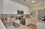 Pantry, stainless steal appliances and granite counters.