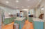 Dynamic Kitchen Boasts Center Work Island, Oversized Wall Oven with Warming Drawer...