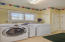 Sunny Laundry Room on Main Floor has Utility Closet and Access to the Garage