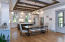 Reclaimed hardwood beam accents throughout