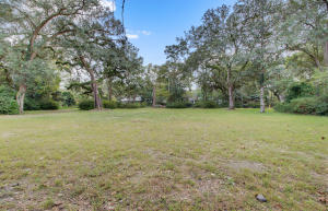 1.16 acre lot in downtown Summerville. The lot has plumbing, electrical, and water to site. The homesite requires no clearing. There are many large oak trees that will frame your Southern home along with mature azaleas throughout the property. The lane that sides to the property could serve as an excellent ingress, it is an easement on the property.  Large vacant lots don't often come available in downtown Summerville, don't miss this opportunity. Seller is willing to subdivide the lot into (2) .6 acre lots (with town approval). Sellers already received from town the first approval on subdivision of lots, that there will be a secondary approval upon execution.