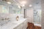 Master Bathroom with huge glass shower. Plumbed for a separate bathtub if desired.