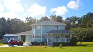 LOCATION, LOCATION, LOCATION  Take a look at this sweet country/suburban gem just minutes from I-26 off of Jedburg Road. Head on down the long, crepe myrtle-lined drive to a charming two-story custom-built home sitting on approximately two cleared acres. A picture-perfect, expansive front porch was made for sweet tea, rocking chairs, and relaxing. Outdoor entertainment/enjoyment is a breeze on the enormous backyard patio and large above-ground pool featuring sturdy stairs and a small deck. Inside is a cozy living room complimented by a gas fireplace. Big beautiful bay windows grace the dining room, which is conveniently close to the efficient kitchen. Enjoy the beauty of the property from the bay windows in the upstairs owners suite. Upstairs are two addit'l bedrooms w/ another full bath Other great features include a generous height crawl space, 2018 HVAC/ductwork, 2014 roof, a newer hot water heater, new laminate hardwood floors in the living/dining rooms/upstairs hall, as well as newer carpet on stairs/upstairs bedrooms.The large shed provides lots of outdoor storage.