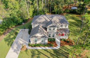 Location,Location, Fantastic Floor Plan in a Charleston Home within minutes from Historic Summerville.This Home sits on over .70 an acre. The Gas Lantern will greet you on the Front Porch. The home is Better than New. As you enter the long Foyer, you will see a stunning dinning room with Trey Ceiling and Chair Molding. A Butlers Pantry with a Beverage Station perfect for Entertaining. The Gourmet Kitchen has a Gas Cook top with a Wall Oven as well as a Kitchen Island with pendent lighting, Beautiful Granite Counters with Soft touch Cabinetry. The Family Room has a Gas Fireplace. The Master Suite is Downstairs with a Huge Closet that would be a Dream for most.   The home a Private Office with French Doors as well as separate WorkStation/ Hobby Area convenient to the Kitchen. The Laundry Room and Half Bath complete the First Floor. Storage is not an issue with multiple closets. At the top of the stairs will be greeted by a large loft/media room, a Jack and Jill Bathroom that joins two Bedrooms and another bedroom with another Full Bathroom. Each Bedroom its own Walk in Closet. The Home has multiple closets for storage. The home has a two car garage with an area for storage, a private screened in porch. This home is a rare find Built in 2015, all the Features, and the lot size. Come See!