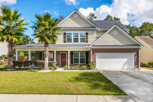 WOW!! The home is located on a small quiet cul-de-sac street in Wescott Plantation that backs up to a small wooded buffer and the golf course.  Just minutes from Dorchester rd, the neighborhood pool, golf, and everything Wescott has to offer.  The exterior features a 2018 architectural style roof, wrap around front porch, widened drive way with paved path to the back, large screened in back patio, full privacy fence, and well maintained landscape with lots of palms to enjoy. Upon entering the interior, the home features formal dining and flex space, can be used for formal living or office.   All carpeted areas have been replaced with luxury laminate flooring throughout the home. There is a huge family room providing open living space. The family room has a granite lined gas fireplace. There is a good size  bedroom on the first floor that shares the downstairs bathroom.  The kitchen features upgraded cabinets, beautiful granite counters, and a wonderful stainless appliance package. Upstairs there are 3 more large bedrooms and a full bath. Also upstairs is a huge Master Suite featuring trey ceiling and an enormous walk in closet. The master bath has separate tub and shower and a double sink vanity that will give you plenty of room. As an added value there is a HUGE bonus room that can be used as a 6th bedroom with dual closets or an entertainment room.  This home is the total package, come see for yourself.