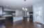 View of Kitchen Area, Family Area, Dining Area, and Back Porch Door