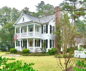 This fabulous house stands prominently on ''the hill'' of East Carolina Street in the Historic District. 107 East Carolina Street, with authentically scaled double front porches and the elegant height of a period house, would be a town landmark except that it is not historic; in fact, it's almost new! Designed to fit right in with surrounding houses primarily built in the 1800's, the house is stunning with its classic architecture and pristine condition. With a wide center hall and very large doorways, the traditional rooms are open and light;. The indispensable work areas, including an office and the world's best mudroom, are convenient and functional. A recently redesigned kitchen is beautiful and sleek with top-notch appliances, large pantry, adjacent breakfast room, farmhouse sink, and center island with tons of drawers. The master bedroom has two walk-in closets, a newly renovated marble bathroom, and  opens to the porch. Two more bedrooms on the second floor share a bathroom. The third floor has a wonderful playroom/office/media room, another bedroom and bathroom. There are window seats, bonus spaces and plenty of storage.  This house is impressive but it is the outdoor space that makes the property so special.   The beautifully planned  landscape must be seen to be appreciated. Included are walkways, courtyard guest parking, a carport and workshop at the rear, a brick patio with seating and fire pit, and all are surrounded by a lush lawn and white picket fencing.  Garden photos will be added.