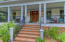 Welcoming wrap around front porch invites you in!