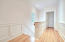 Upstairs hallway has a wonderful amount of natural light and its hard to miss the beautiful hardwood floors that run throughout this home!