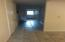 hallway to utility room with washer and dryer