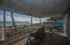 Main floor covered deck overlooking the ocean