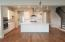 Large kitchen with split cooking and gas cooktop