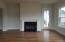Family room with fireplace. Door to rear covered porch