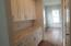 Butlers pantry from kitchen to dining room. Door to large walk in pantry