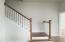 Hardwood stairs leading to 2 addtional bedrooms and bathrooms plus the walk in attic storage