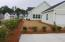 Corner home site with spacious yard and large driveway
