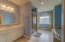 Large master bath with his and her walk in closets.