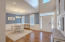 Gorgeous hardwood flooring welcomes you in to an open formal dining area.