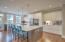 Gourmet kitchen showcases marble countertops and large island