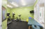 Exercise room on lower level large enough for treadmill, elliptical and free weights