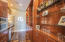 Wet bar on lower level equipped with refrigerator, dishwasher, microwave and ice maker